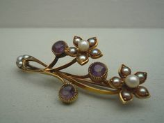 A beautiful antique 15 carat gold, amethyst and seed pearl brooch in the original JW Benson Ltd box.  In the typical naturalistic style of the Victorian period this is an excellent quality brooch in very good condition - the only fault I can see is the tiniest flea bite on the amethyst between the 2 flowers, hard to see and so far impossible to photograph. The brooch is fairly small measuring approximately 1 5/8 inches, 4.3 cm across.  The brooch is secured with a simple pin and C clasp ...
