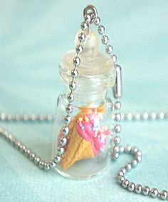 This necklace features a jar pendant adorned with strawberry ice cream cones sculpted from polymer clay. The glass jar measures about cm tall and is securely attached to a silver tone ball chain necklace that measures in length. Bottle Jewelry, Bottle Charms, Bottle Necklace, Glass Bottle, Jewelry Shop, Miniature Bottles, Miniature Crafts, Bff, Kawaii Diy