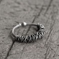 An absolutely stunning wire ring from the Egret collection. Moulded from sterling silver into intricate wires wrapping around a silver band. Material: Sterling Silver Ring Size: M-T Width: Wire Rings, Wire Wrapped Rings, Unique Rings, Statement Jewelry, Wire Wrapping, Sterling Silver Rings, Diy Jewellery, Jewellery Making, Gold Jewelry