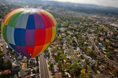 """""""Balloon Over Reno 2"""" - This hot air balloon was photographed over Reno, Nevada during the 2011 Great Reno Balloon Race. The """"toy"""" like effect was achieved using a tilt-shift lens."""