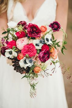 gorgeous colors, photo by Crystal Stokes http://ruffledblog.com/southern-simplicity-wedding-ideas #flowers #bouquets #anemones