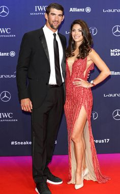 Michael Phelps & Nicole Phelps from The Big Picture: Today's Hot Photos  The Olympic swimmer and his wife pose on the carpet during the2017 Laureus World Sports Awards in Monaco, France.