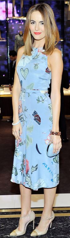 Camilla Belle's blue print dress, stud cap toe pumps, and clutch handbag that she wore in Beverly Hills