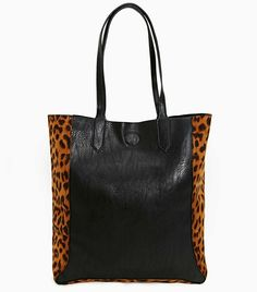 A dash of leopard takes this luxurious tote to the next level. via @WhoWhatWear