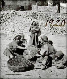 Palestinian women crushing olives in order to make olive oil in 1920.