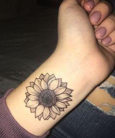 Sunflower Tattoo Ideas on Wrist Looks Stunning for Girls #TattooIdeasForGirls #TattooIdeasWrist