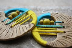 Natural round wooden earrings with yellow-blue thread and wooden beads