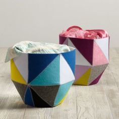 Meet a softer, kinder, gentler kind of quartz.  Crafted from felt pieces and sewn into prism like configurations, no two sides of these felt cube bins are the same.