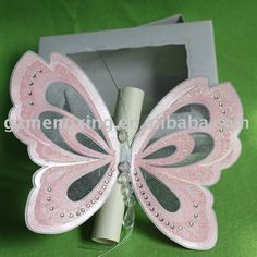 Butterfly Invitation rolled up as a Butterfly