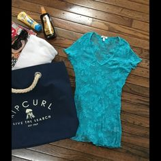 CACHE' TOP/COVERUP Beautiful Cache' turquoise color blouse/coverup. Can be worn over tank top or as a sexy cover up for your swimsuit. Mesh see through as shown in picture. Tag says large, although it is stretchy, I would say more like a small/medium. Cache Tops