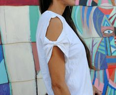 The cold shoulder top is taking over from the runway to street style and everything in between. It's a cute ...