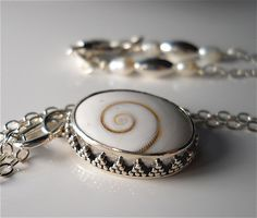Shiva eye shell and sterling silver finished pendant