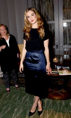 Pin for Later: Cinderella's Lily James Has Already Proven She's Princess Material Lily James A party at Claridge's was an opportunity to show off a navy pencil skirt and simple black top.