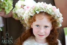 Meredith's flower girl wore a halo of antique green hydrangea and soft pink spray roses in her hair. #dorothymcdanielsflowermarket #alabamaflorist #southernwedding #blushflowers #flowergirlflowers