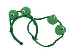 each on the bottom of each cup (the green side).      Using a pencil, poke holes through both sides of the egg cups, and string the cups on to a pipe cleaner.      Use the pipe cleaner to attach your egg cups to the headband, or twist more pipe cleaners together until it is long enough to fit around your head.      Put on your frog eyes, and have fun jumping and croaking like a frog! RIBBIT!