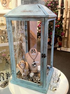 I love the idea of using a re-purposed lantern for display but I would probably take out the glass so that the guest could access whatever was inside without having to find an associate or just in case everyone was busy. #JewelryDisplays