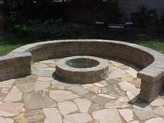 Google Image Result for http://www.progressivelawnscaping.com/files/images/Belgard%2520%27Weston%27%2520Seating%2520Wall%2520Around%2520Fire%2520Pit.preview.JPG