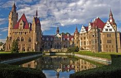 Pałac w Mosznej: The castle in Moszna is one of the best known monuments in the southern Poland. The castle and park complex is the former residence of the German Tiele-Winckler family. This gigantic 7,000 square and 65,000 cubic meter construction was started in the 17th century. It contains 365 rooms and 99 turrets. It is reminiscent of English castles from the Elizabethan period. The stud farm with thoroughbred Arab horses attracts many enthusiasts of equestrian sports.