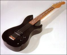 A guitar shaped coffin. Yes it's for real.