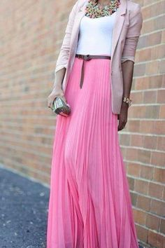 working the pink long skirt with a pastel pink blasor