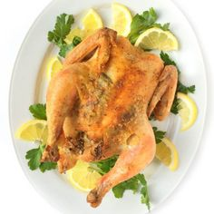 The ultimate comfort food, this simple roasted chicken is seasoned with lemon, garlic and salt.