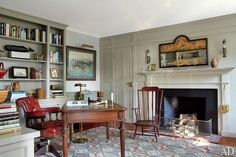 Arie L. Kopelman, a former Chanel president, and his wife, Coco, remodeled their dream house on the Massachusetts isle of Nantucket and filled it with their noteworthy collection of antiques. The pine-paneled office, painted an elegant pale gray, hosts a 19th-century English desk chair and writing table and an overmantel mirror from Robert Young Antiques | archdigest.com