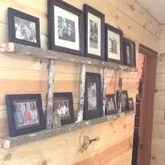 This is part of an old wooden ladder my dad had. We cut it down to fit the space. It looks great as a place to hold pictures.