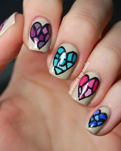 dressedupnails:    It's time for another Digit-al Dozen week and this week's theme is Love & Heartbreak. I um really love painting hearts on my nails so expect mostly love and not as much heartbreak haha. I've been wanting to do these stained glass heart nails for a long time and I love how they turned out! Check out the full post for more pictures and how I did them.  Facebook | Instagram | Twitter