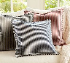 Navy striped pillow for the living room couch: Thomas Ticking Stripe Pillow Cover #potterybarn