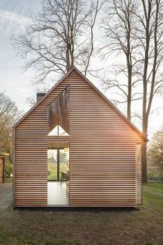 Recreation House near Utrecht by Zecc ArchitectenOn the long side of the closed façade all facilities are integrated into a wall of oak: the kitchen, wood stove, a toilet, shower, sink and several cabinets. Every square inch of the house is used and thought out.
