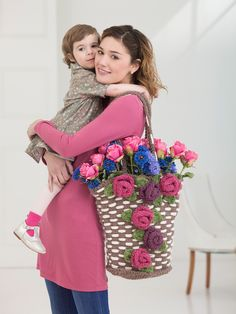 Make this beautiful flower bag for mom this Mother's Day! Free knit pattern - make it with Wool-Ease Thick & Quick! Crochet pattern also available!