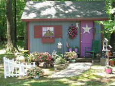 This shed is a backdrop to a fairy tale style whimsical garden.