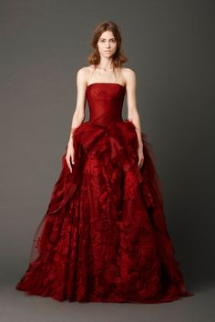 Crimson strapless ballgown with hand-draped tulle bodice and honeycomb tulle skirt with embellished floating Chantilly lace and bias-cutorganza ruffle detail