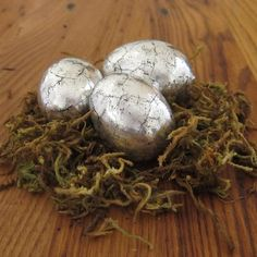 Turn plastic eggs into gorgeous antiqued silver eggs using tin foil.