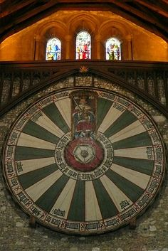 Cool! The round table, Great Hall, Winchester Castle, thought to be King Arthur's round table, belonging to King Edward 1st.