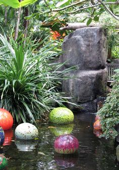 Chihuly glass in koi pond.  A girl can dream...  Like I'll ever afford Chihuly glass, let alone to leave OUTSIDE! :)