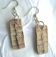 Earrings made in pale red in paper clay