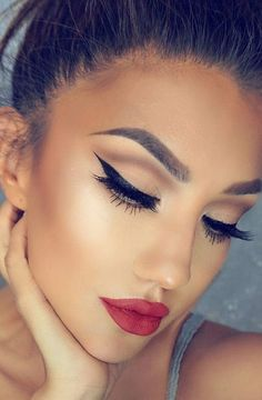 makeup. beauty. eyeliner. red lipstick. lashes. style.