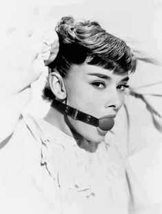Is that Audrey Hepburn wearing a ball gag? …google image search… That is indeed a  shopped picture of Audrey Hepburn wearing a ball gag.