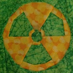 The Incredible Hulk's symbol by @liljabs, free paper pieced pattern, fandominstitches.com