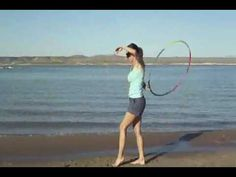 Behind The  Back Turn (& Toss): http://www.hooping.org/2012/07/hooping-tutorials-behind-the-back-turn/