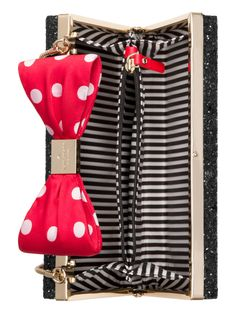 covered with chunky glitter and decorated with an unmistakable minnie mouse bow, this frame clutch (which also features an hidden snake chain) is the perfect way to add a bit of whimsy to your little black dress.