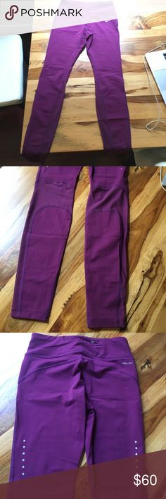 Nike Power Epic Lux Women's Running Tights Gorgeous purple drifit leggings with mesh detail on the back of the legs. Purchased and worn once. EXCELLENT condition. Drawstring waist and two pockets in the waistband in the front and back as well as a zip pocket in the back. These are the full length version of this legging. Nike Pants Leggings