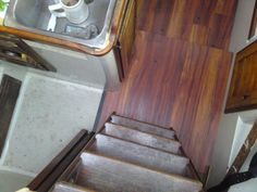 We put vinyl flooring in our sailboat. Much better than the fiberglass original! And it isn't real teak, so it won't ever rot out on us, though it is still very pretty (we think).