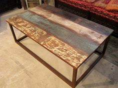 rustic wood and iron coffee table...perfect for a kitchen table or bar top!