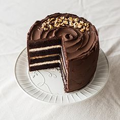 Snickers Cake. Fudgy chocolate cake, salted caramel filling with peanuts, peanut butter filling and dark chocolate ganache.