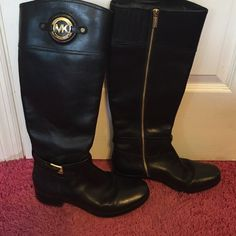 Michael Kors Boots Pre-owned with some signs of wear. The MK logos have scratches as pictures and there are some small scuffs in the leather of the boots that could probably be polished away. I've price these accordingly. No box included. Michael Kors Shoes Winter & Rain Boots