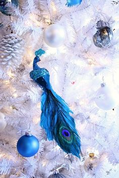 more blue christmas - peacock  Colors pop on this white tree.