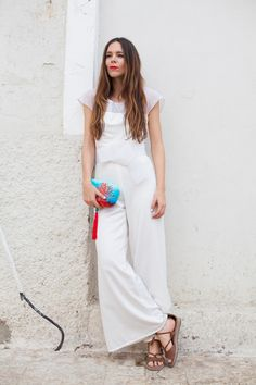 An all white outfit is super chic, and means you can go all out with the accessories! How gorgeous is this blue and red clutch bag?