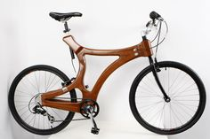 A unique hand-made wooden bike / mahogany bicycle. $5,250.00, via Etsy.